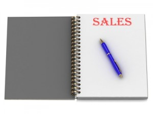 SALES word on notebook page