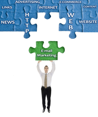 E-mail Marketing word on puzzle in man hands
