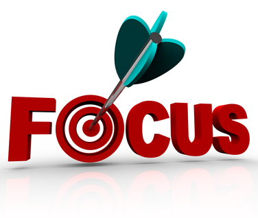 Focus Word with Arrow Hitting Target Bulls-Eye