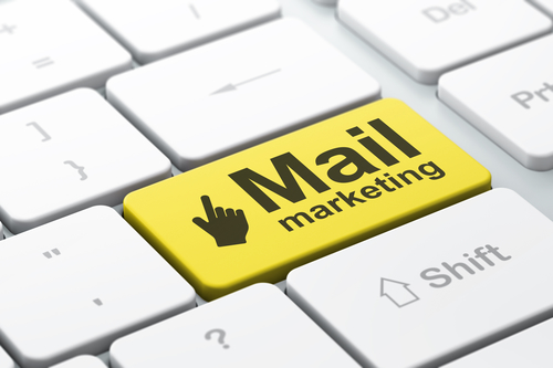 Advertising concept: Mouse Cursor and Mail Marketing on computer